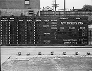 "Ackroyd 00037-57. ""International Totalizer Machine. Multnomah Stadium. Cashiers machines. August 15, 1946."" on-track betting machines for races at Multnomah Stadium.  electronic billboard showing odds, pay and results, International Totalizer Company, San Mateo, California."