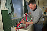 Reconditioning a bicycle frame at the Inside Out trust workshop