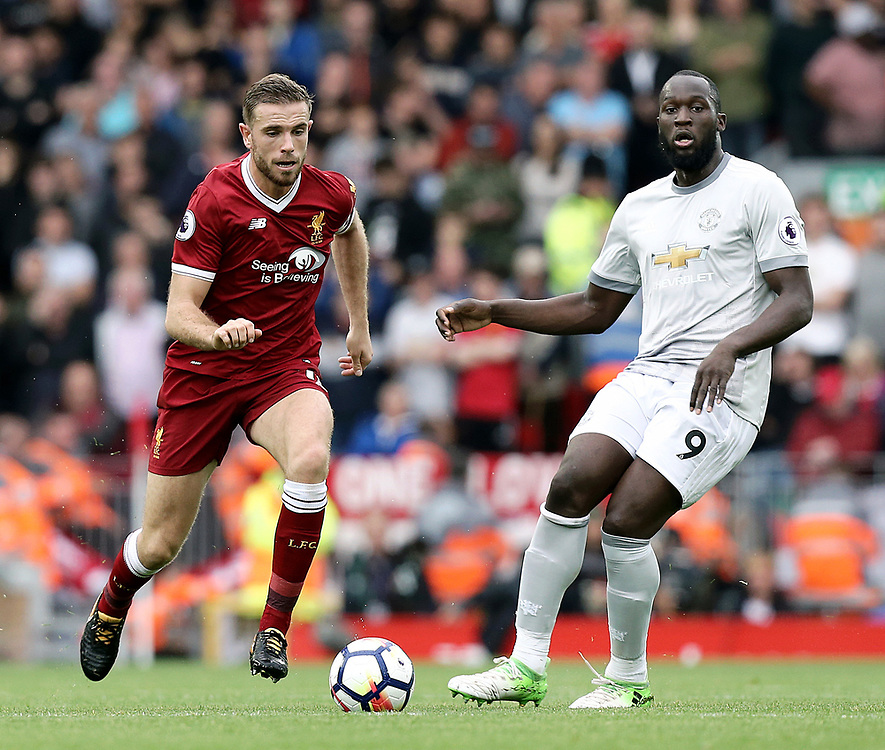 Liverpool's Jordan Henderson runs past Manchester United's Henrikh Mkhitaryan (left) and Romelu Lukaku<br /> <br /> Photographer Rich Linley/CameraSport<br /> <br /> The Premier League - Liverpool v Manchester United - Saturday 14th October 2017 - Anfield - Liverpool<br /> <br /> World Copyright © 2017 CameraSport. All rights reserved. 43 Linden Ave. Countesthorpe. Leicester. England. LE8 5PG - Tel: +44 (0) 116 277 4147 - admin@camerasport.com - www.camerasport.com