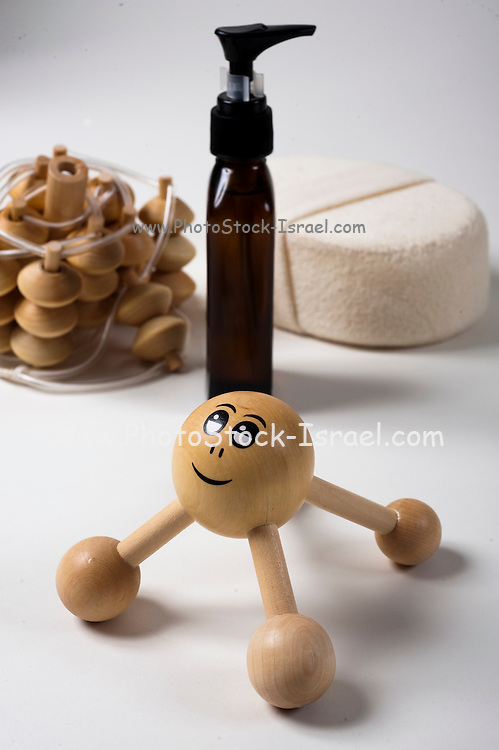 Cutout of massage aiding tools and massaging oil on white background