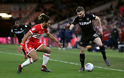 Leeds United's Stuart Dallas (right) and Middlesbrough's Ryan Shotton battle for the ball during the Sky Bet Championship match at the Riverside Stadium, Middlesbrough.