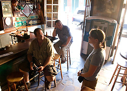 10 Sept 2005. New Orleans, Louisiana. Hurricane Katrina aftermath. <br /> My fellow journos at Molly's  bar on Decatur Street. The famous French Quarter bar remained open throughout the days following the storm.<br /> Photo; ©Charlie Varley/varleypix.com