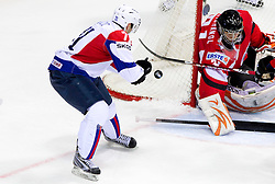 Bostjan Golicic of Slovenia vs Fabian Weinhandl of Austria during ice-hockey match between Austria and Slovenia of Group G in Relegation Round of IIHF 2011 World Championship Slovakia, on May 7, 2011 in Orange Arena, Bratislava, Slovakia. (Photo By Vid Ponikvar / Sportida.com)