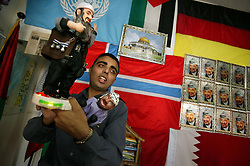 Tareq Abu Dayyeh, shows customers Osama Bin Laden and Yasser Arafat toys, Gaza, Palestinian Territories, Nov. 9, 2004. Sales of Arafat keepsakes have increased over the past week at the Palestine Liberation Organization Flag Shop. Arafat was diagnosed with liver failure while in critical condition in a Paris hospital.