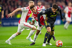 10-04-2019 NED: Champions League AFC Ajax - Juventus,  Amsterdam<br /> Round of 8, 1st leg / Ajax plays the first match 1-1 against Juventus during the UEFA Champions League first leg quarter-final football match / David Neres #7 of Ajax, Rodrigo Bentancur #30 of Juventus