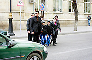 An Azeri family tries to cross the street but cars keep passing by at high speed. Azeri GDP grew 41.7% in the first quarter of 2007, possibly the highest of any nation worldwide, as the country economy completed its post-Soviet transition into a major oil based economy.<br /> Baku was awarded the right to host of the first European Games, a multi-sport event.