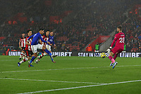 Football - 2019 / 2020 Premier League - Southampton vs. Leicester City<br /> <br /> Ayoze Perez of Leicester City fires the ball past Southampton's Angus Gunn to score his hat trick at St Mary's Stadium Southampton<br /> <br /> COLORSPORT/SHAUN BOGGUST