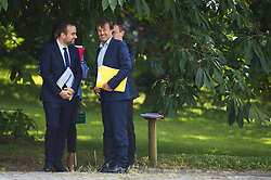 French Minister for the Ecological and Inclusive Transition Nicolas Hulot (C) speaks with French State Secretary of Ecological Transition Sebastien Lecornu during a biodiversity conference at Museum national d'Histoire naturelle in Paris on July 4, 2018. Photo by Eliot Blondet/ABACAPRESS.COM