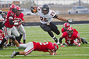 Gladewater's Darnell McKinght powers through Gainesville defenders during their game at Royce City ISD Stadium on Saturday.© 2013 Jaime R. Carrero/Carrero Photography