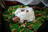 """DRC / Burundi Refugees / 1 year-old Zawadi (which means """"gift"""") lies on her bed in a hospital in DRC's South<br /> Kivu Province where she is being treated for malaria and anemia. She arrived in DRC<br /> with her mother and two siblings at the end of April.<br /> <br /> 7,661 Burundians refugees have crossed into the DRC over the past few weeks. The new<br /> arrivals are being hosted by local families, but the growing numbers are straining<br /> available support. UNHCR is helping some 500 vulnerable refugees at a transit centre<br /> at Kavimvira and in another centre at Sange. Work is ongoing to identify a site<br /> where all the refugees can be moved, and from where they can have access to<br /> facilities such as schools, health centers and with proper security. / UNHCR / F.Scoppa / May 2015"""