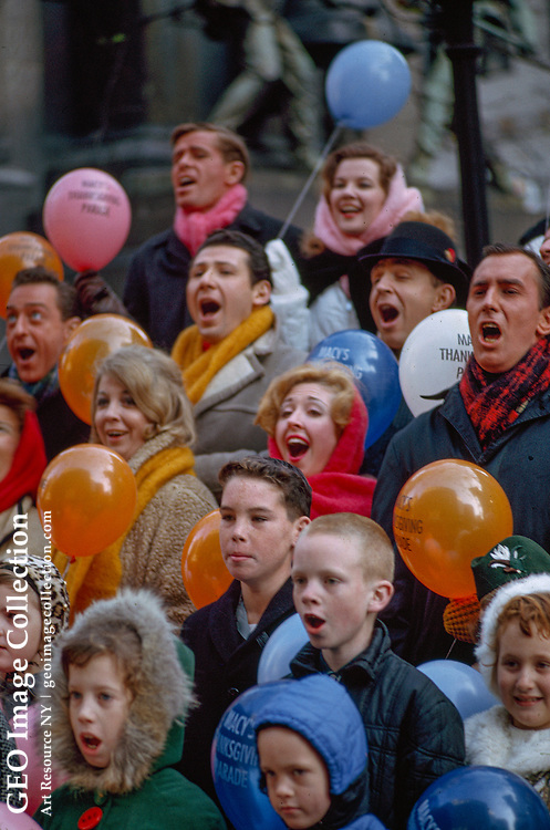 Spectators exclaim in delight at the Macy's Thanksgiving Day parade.
