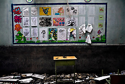 A desk is seen at Liuhe community school damaged by the earthquake is seen in Dujianyan, Sichuan province in China.