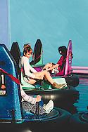 A pretty twenty-something girl on an amusement park ride.