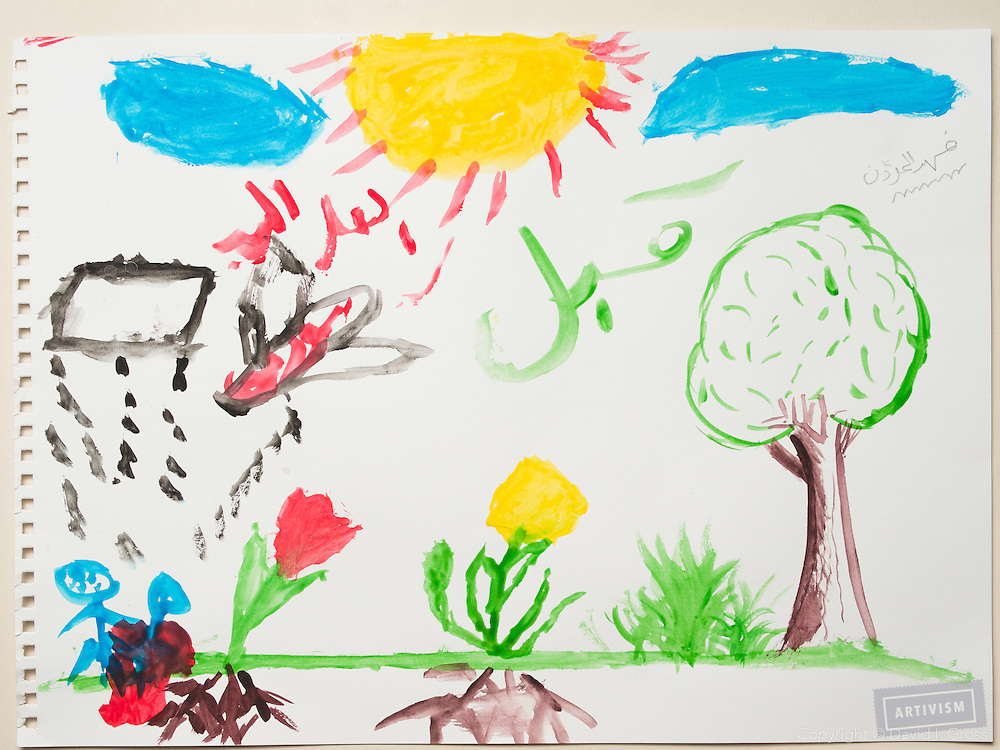 Durng the war: planes drop bombs on us while we are outside. Drawing by a 10 year old Syrian boy. (Topic for session: draw your impression of life before, during and after the war.)
