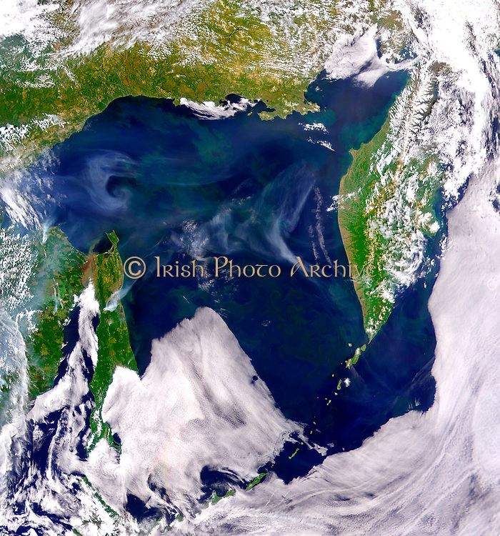 Smoke Across Sea of Okhotsk  Images & Animations NASA/Goddard Space Flight Center, and ORBIMAGE Smoke from fires in eastern Russia hangs over the Sea of Okhotsk in this SeaWiFS image from July 2, 2003. On July 2, 2003, the Sea-viewing Wide Field-of-View Sensor (SeaWiFS) collected this image of the Sea of Okhotsk, east of Russia. Patchy phytoplankton blooms fill the surface waters, coloring them green. Turbid, brownish water flows from the Amur River into Tartar Strait, between mainland Russia and Sakhalin Island (left of image center). Smoke from regional fires drifts across the sky