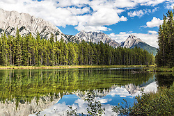 Gap Mountain and Mount Wintour reflecting in the still waters of Lower Kananaskis Lake at Peter Logan Provincial Park in Kananaskis Country in Alberta Canada's Canadian Rockies