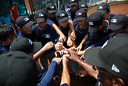 Blue Stars players gather for a talk after loosing an exhibition game at a summer training camp run by Major League Baseball Wuxi, China, on 19 August, 2010.  Targeting teenagers between the ade of 12-15, the league hopes to use the camp to groom potential baseball talent in China and in the long term increase the popularity of the sport in the world's most populous country.