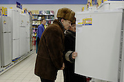 Moscow, Russia, 03/01/2004..Customers inspecting refrigerators in the Mosmart shopping mall.
