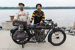 Shinya Kimura and Yoshimasa Nimi of Chabott Engineering's Team-80 with their 1915 Indian twin beside the Mississipi River in Cape Gerardeau during the Motorcycle Cannonball Race of the Century. Stage-5 from Bloomington, IN to Cape Girardeau, MO. USA. Wednesday September 14, 2016. Photography ©2016 Michael Lichter.
