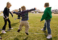 First grader Adam Kotzian (C) plays a game with classmates during physical education at Eagleview Elementary school in Thornton, Colorado March 31, 2010.  Adam and his parents are achondroplasia dwarfs but his sister Avery is not.   REUTERS/Rick Wilking (UNITED STATES)