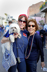 31 January 2016. New Orleans, Louisiana.<br /> Mardi Gras Dog Parade. Lisa, her mum and Wheezy. The Mystic Krewe of Barkus winds its way around the French Quarter with dogs and their owners dressed up for this year's theme, 'From the Doghouse to the Whitehouse.' <br /> Photo©; Charlie Varley/varleypix.com