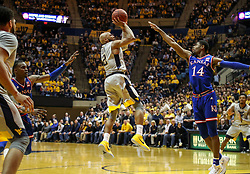 Jan 15, 2018; Morgantown, WV, USA; West Virginia Mountaineers guard Jevon Carter (2) shoots a jumper during the second half against the Kansas Jayhawks at WVU Coliseum. Mandatory Credit: Ben Queen-USA TODAY Sports