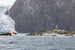 Guests On Zadiak Viewing Buste of Captain Luis Pardo'. Chinstrap Penguins, Point Wild, Elephant Island