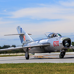 Lancaster, PA, USA - August 22, 2015: A MIG-17 jet returns from a fly-over at Lancaster Airport Community Days air show.