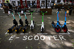 © Licensed to London News Pictures. 07/06/2021. London, UK. E-scooters are available to rent in Sloane Square in central London on the first day of availability. E-scooters have become available to hire in four boroughs in London in a trial starting today. Photo credit: Peter Macdiarmid/LNP