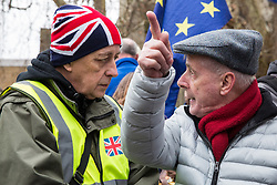 London, UK. 29th January, 2019. Rival pro- and anti-Brexit protesters debate outside Parliament on the day of votes in the House of Commons on amendments to the Prime Minister's final Brexit withdrawal agreement which could determine the content of the next stage of negotiations with the European Union.