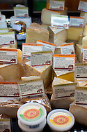Foster and Dobbs, in a neighborhood in NE Portland, Oregon.  A variety of cheeses that the store carries.