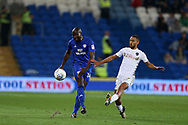 Sol Bamba of Cardiff city (l) passes the ball while under pressure from Kemar Roofe of Leeds Utd. EFL Skybet championship match, Cardiff city v Leeds Utd at the Cardiff city stadium in Cardiff, South Wales on Tuesday 26th September 2017.<br /> pic by Andrew Orchard, Andrew Orchard sports photography.