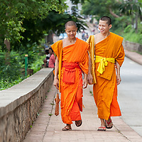 Two monks walking together in Luang Prabang.