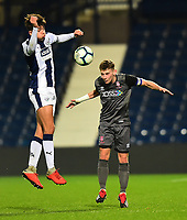 Lincoln City U18's Charlie West heads clear under pressure from  West Bromwich Albion U18's Zak Brown<br /> <br /> Photographer Andrew Vaughan/CameraSport<br /> <br /> FA Youth Cup Round Three - West Bromwich Albion U18 v Lincoln City U18 - Tuesday 11th December 2018 - The Hawthorns - West Bromwich<br />  <br /> World Copyright © 2018 CameraSport. All rights reserved. 43 Linden Ave. Countesthorpe. Leicester. England. LE8 5PG - Tel: +44 (0) 116 277 4147 - admin@camerasport.com - www.camerasport.com