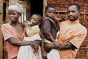 A family in rural Butare, Rwanda, living in the Simbi Area Development Program (ADP) run by the international nonprofit World Vision. Area Development Programs work within communities like Butare over a period of several years, providing developmental resources to foster long-term, sustainable growth in the economic and physical well being of the community.