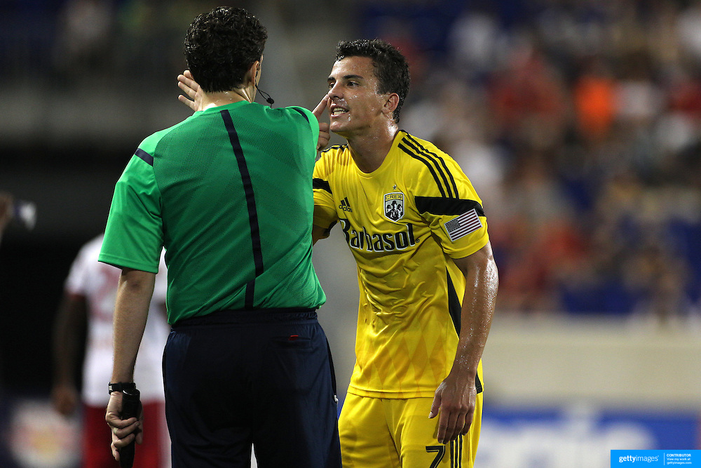 Sent off player Bernardo Anor, (right), Columbus Crew, remonstrates with the lineman after receiving a red card during the New York Red Bulls Vs Columbus Crew, Major League Soccer regular season match at Red Bull Arena, Harrison, New Jersey. USA. 12th July 2014. Photo Tim Clayton