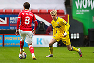 AFC Wimbledon midfielder Jack Rudoni (12)about to tackle Charlton Athletic midfielder Jake Forster-Caskey (8) during the EFL Sky Bet League 1 match between Charlton Athletic and AFC Wimbledon at The Valley, London, England on 12 December 2020.
