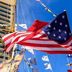 A US flag on a ship in Inner Harbr flaps in the wind.