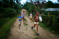 BARACOA, CUBA - CIRCA JANUARY 2020: Cuban kids running in the area around Bahia de Mata, a village close to Baracoa in Cuba.