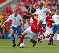 Photo: Leigh Quinnell.<br /> Nottingham Forest v Brighton & Hove Albion. Coca Cola League 1. 19/08/2006. Nottingham Forests Gary Holt dives between Brightons Richard Carpenter(L) and Joel Lynch.