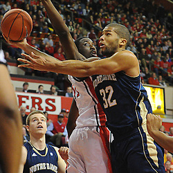 Notre Dame Fighting Irish guard Joey Brooks (32) tucks a layup behind Rutgers Scarlet Knights guard/forward Dane Miller's (11) attempted block during Big East NCAA action during Rutgers' 65-58 victory over Notre Dame at the Louis Brown Athletic Center in Piscataway, N.J.