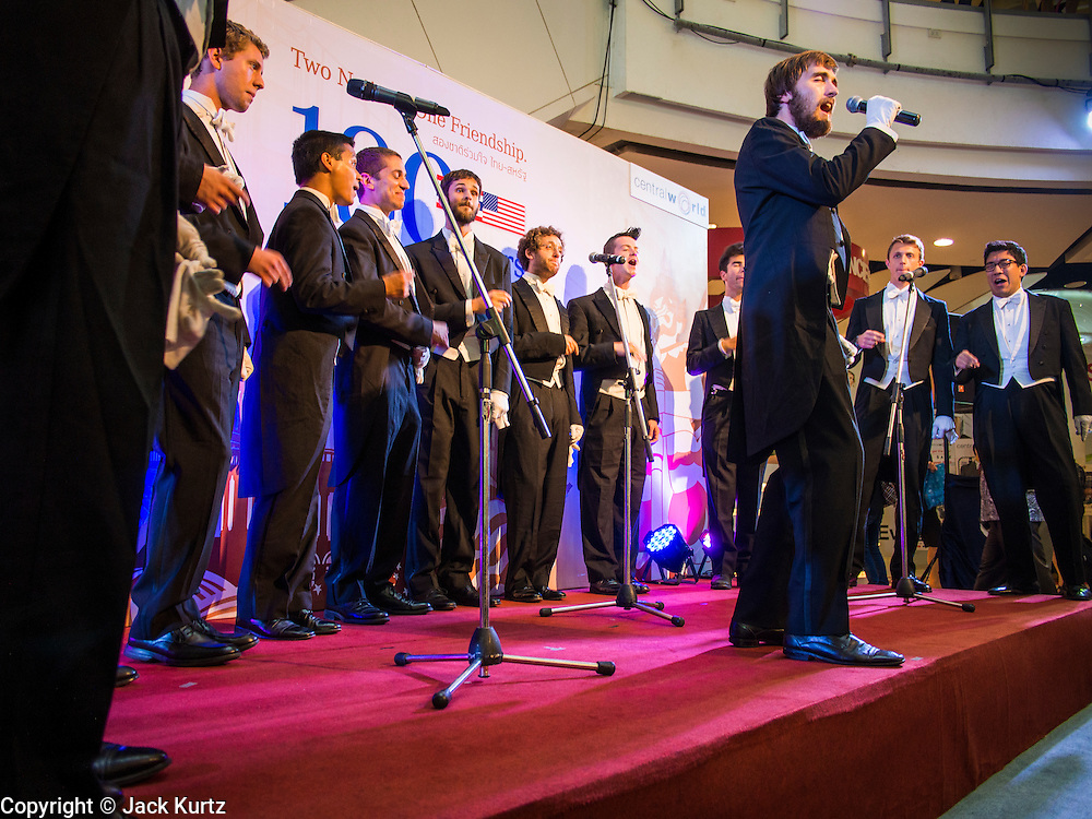 """19 JULY 2013 - BANGKOK, THAILAND:   DANIEL REARDON, a  Yale senior East Asian Studies major, fronts the Whiffenpoofs during their show in Bangkok Friday. The Yale Whiffenpoofs, one of the best-known collegiate a cappella groups in the world performed in CentralWorld in Bangkok Friday. Founded in 1909, the """"Whiffs"""" began as a senior quartet that met for weekly concerts at Mory's Temple Bar, the famous Yale tavern. The Bangkok stop was a part of their 2013 world tour and was sponsored by the US Embassy. They sang at the opening of a photo exhibit that marked 180 years of friendly diplomatic relations between Thailand and the United States.   PHOTO BY JACK KURTZ"""