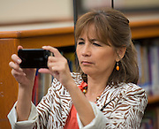 Houston ISD Chief Communications Officer Aggie Alvez prepares to Tweet a photo from a press conference following a Broad Foundation research team tour Ortiz Middle School, May 29, 2013.