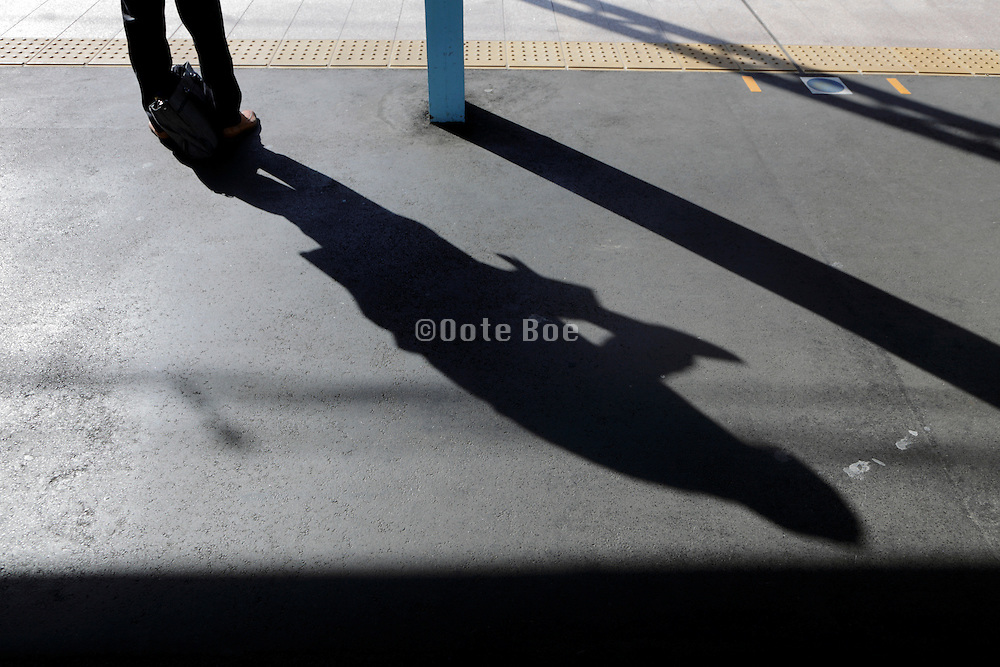 businessman waiting for the train