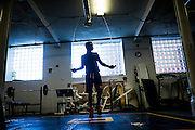 A teen boy works out in the Braddock Community Center gym on May 27, 2016 in Braddock, Pennsylvania, USA.<br /> <br /> The Western Pennsylvania branch of the Police Athletic League runs a boxing program in the basement of the Braddock Community Center, which used to be a church.<br /> <br /> The program is free to everyone between the ages 8 and 18 and anyone currently attending high school. Its goal is to create relationships between volunteers and local kids, to help steer them away from crime, violence and drugs and be surrounded by positive influences.