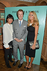 Left to right, CLAUDIA WINKLEMAN, TOM PARKER BOWLES and TESS DALY at a party hosted by Ewan Venters CEO of Fortnum & Mason to celebrate the launch of The Cook Book by Tom Parker Bowles held at Fortnum & Mason, 181 Piccadilly, London on 18th October 2016.