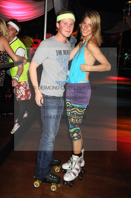 GUY PELLY and SUSANNA WARREN at a Roller Disco in aid of Tom's Ward at the Children's Hospital in Oxford and the charity Place2Be, held at The Renaissance Rooms, London SW8 on the 17th September 2008.<br /> GUY PELLY and SUSANNA WARREN at a Roller Disco in aid of TomÕs Ward at the ChildrenÕs Hospital in Oxford and the charity Place2Be, held at The Renaissance Rooms, London SW8 on the 17th September 2008.