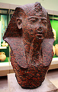 Head of a 19th Dynasty Pharaoh about 1250 BC. Made of red granite, this head, wearing royal headdress, depicted a New Kingdom pharaoh, possibly Ramses II.