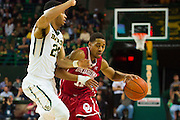 WACO, TX - JANUARY 24: Isaiah Cousins #11 of the Oklahoma Sooners drives to the basket against the Baylor Bears on January 24, 2015 at the Ferrell Center in Waco, Texas.  (Photo by Cooper Neill/Getty Images) *** Local Caption *** Isaiah Cousins