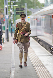 100 years to the day from when the celebrated Great War poet Wilfred Owen arrived for treatment in Edinburgh the ocassion was marked with a re-enactment of that arrival and the historic walk he made along Princes Street. Pictured is Wilfred Owen, played by David Clarke of the Scots in the Great War Living History Society arriving at Waverley Station in Edinburgh.<br /> © Dave Johnston/ EEm